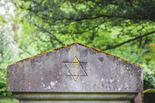 Star Of David On An Old Headstone In An Ancient Jewish Cemetery