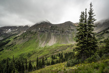 The Washington Section Of The Pacific Crest Trail In The North Cascades With View Of Cloud Covered Rocky Mountains And Snow.