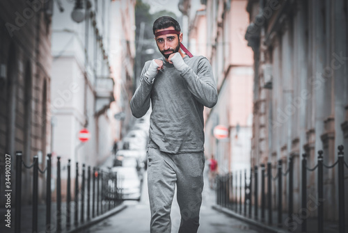 Athlete runs through the streets of the city Canvas Print