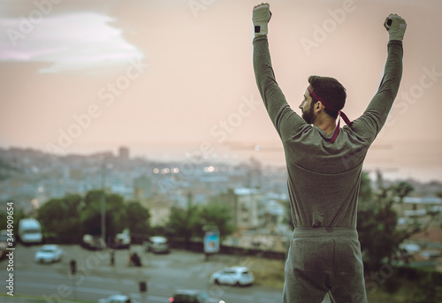 The man's back view in a suit celebrates the victory. Wallpaper Mural