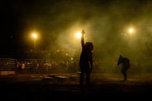 Rodeo Workers From Brazil. Announcer Calls To The Crowd During Rodeo Show At An Arena In Brazil.