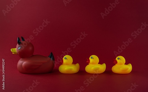 Duck bath toys isolated on a red background
