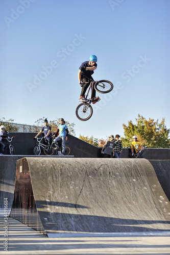 High jump on a bmx bike in a skatepark