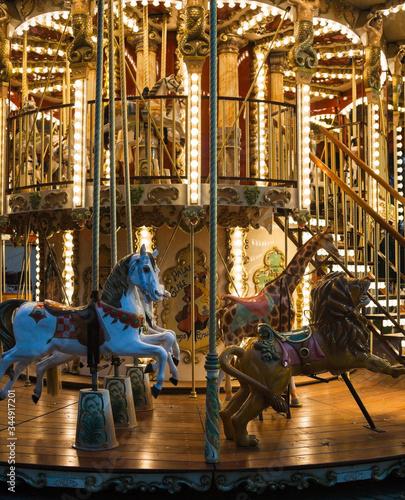 Valokuvatapetti Colorful merry-go-round with the night illumination.