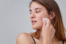 Young Woman Uses Gua Sha Stone