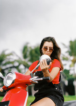 Young Girl Posing On A Red Scooter, Funny Portraits