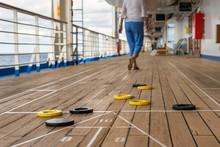 Playing Shuffleboard On A Cruise