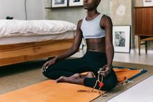 Black Woman Meditating Next To...