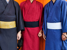 Three Man Wearing A Kimono
