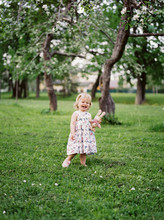 Laughing Child In Apple Garden