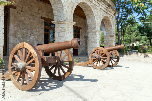 Medieval cannon at the entrance to the Khans palace in the Naryn-Kala fortress Wallpaper Mural
