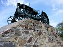 Monument To The Old Tractor On Stone Stopped.Russia.