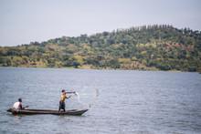 Fisherman Casting His Net On Lake Victoria Uganda