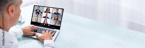 Fototapeta Businessman Videoconferencing With Colleague On Laptop obraz na płótnie