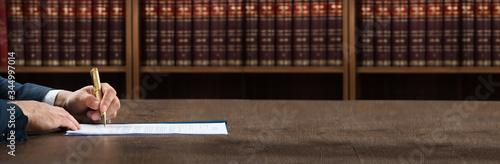 Obraz na plátně Lawyer Writing On Legal Documents At Desk