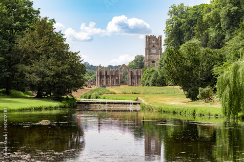 Fountains Abbey and Studley Royal on a warm summer day. Canvas Print
