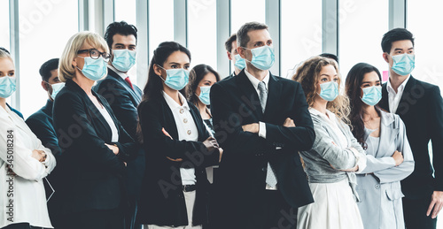 Obraz Confident business people with face mask protect from Coronavirus or COVID-19. Concept of help, support and collaboration together to overcome epidemic of Coronavirus or COVID-19 to reopen business. - fototapety do salonu