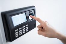 Closeup Woman Finger Using Biometric Fingerprint Attendance System Machine
