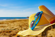 canvas print picture - Sun protection gear on sand beach