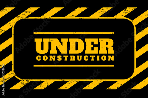 Foto under construction background in yellow and black stripes