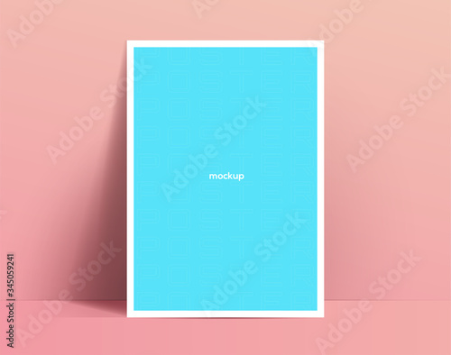 Realistic poster mockup template design. Poster or flyer leans against the wall and drop soft shadow. Vector illustration © paul_craft