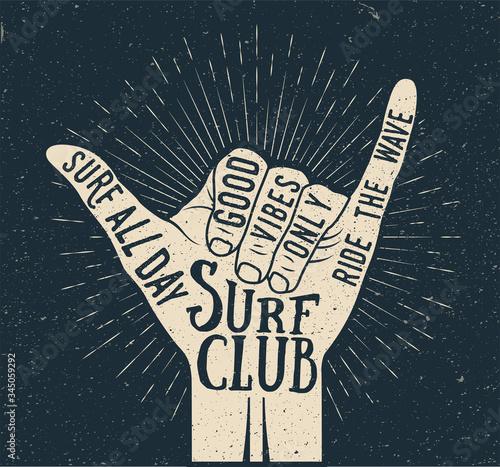Surf shaka hand gesture silhouette on dark background. Summer time surfing themed vintage styled vector illustration © paul_craft