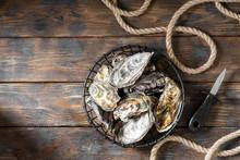 Lots Of Oysters In A Black Met...