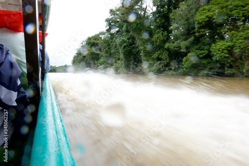 Image from a blue boat capturing the wake of the water in an Amazon river Canvas Print