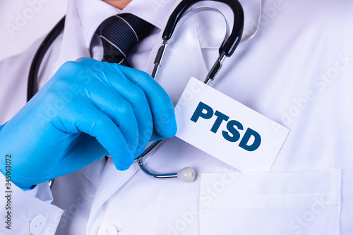 Photo Doctor, man put a card with the text PTSD in his pocket