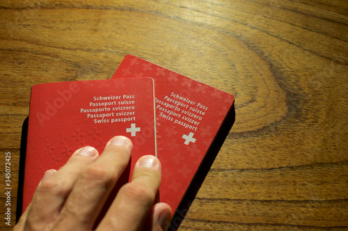 Two Swiss passport on a wooden table Tablou Canvas