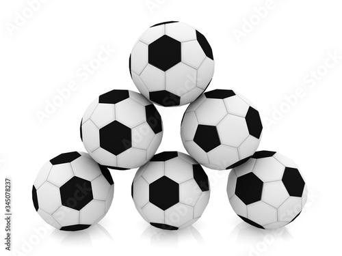 Black and white soccer ball pyramid on a white background