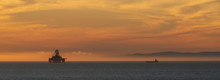 Sunset Over The Moray Firth Including An Oil Rig And Rig Support Vessel