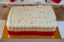 Wedding Cake. White Marzipan Almond Paste Cake With Butterflies, Flowers On Gold Metal Plate Square Shape. White Wedding Cake With Red Details Flowers. Homemade Tasty
