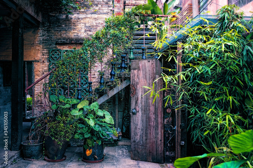 China, old cosy patio in the traditional style, ivy covered staircase Wallpaper Mural