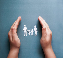 Hands Holding Paper Family Cut...