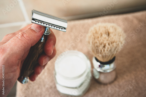 Close-up of safety razor 50s style and male cosmetic products and supplies used by men to shave Wallpaper Mural