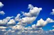 Leinwandbild Motiv Background, Cumulus clouds in a bright blue sky.