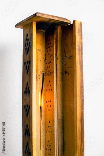 Valokuva lit incense stick in wooden censer