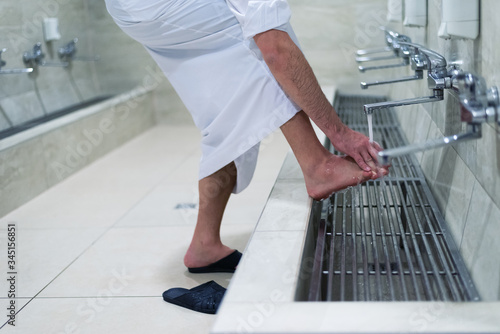 Fototapeta Muslim man taking ablution for prayer