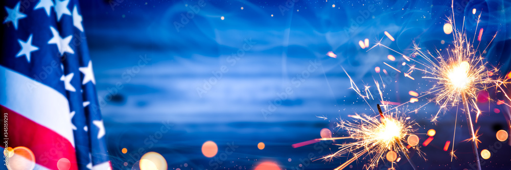 Fototapeta American Flag With Sparklers And Smoke On Wooden Background - Independence Day Celebration Concept