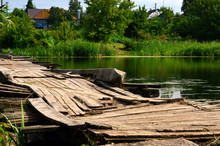 Very Old Wooden Bridge Over The River.