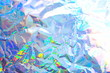 Abstract radiant festive backdrop texture image of holographic bokeh iridescent metallic foil