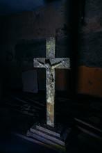 Old Rotten Wooden Statue Of Crucified Jesus Christ In Dark Room