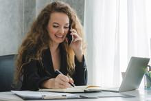 Businesswoman Talking On Mobil...