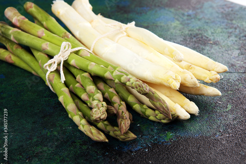 White and green asparagus on rustic background. Canvas Print
