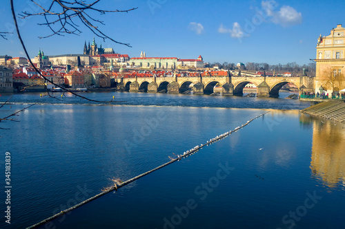 Photo View of the Vltava River and the bridges shined with the sunset sun, Prague