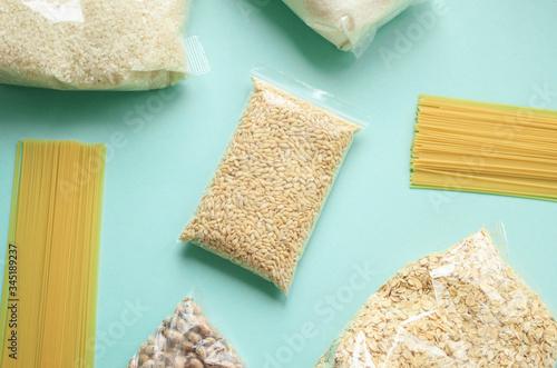 Fényképezés pearl barley, sugar, rice, oatmeal,spaghetti, semolina, beans in a package are o