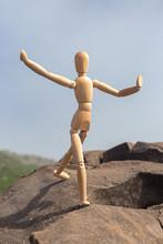 The Figure Of A Wooden Man Jum...