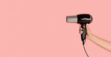 Unrecognizable Girl Showing Hairdryer On Pink Background, Empty Space. Panorama