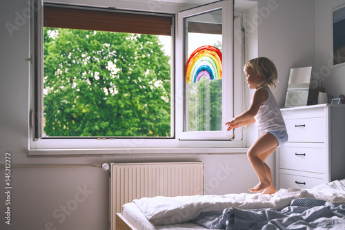 Cute little girl having fun time jumping on bed at home. Canvas-taulu